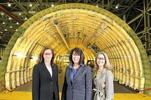 From left, 767 chief Kim Pastega, 737 chief Beverly Wyse and 747 chief Elizabeth Lund wear safety glasses while standing near the aft fuselage of a 747 freighter at the Boeing Everett plant.