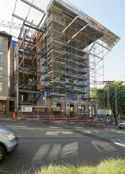 The Madison Street side of the Bullitt Center is still covered in scaffolding as the project approaches completion.