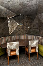 The newly renovated Columbia Tower Club Hunt and Gather bar features this cabana with a faceted metal ceiling treatment.