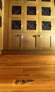 The recycled wine barrel floor around the private wine lockers in the Harvest formal dining room at the newly renovated Columbia Tower Club.