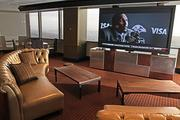 The newly renovated Columbia Tower Club includes couches in front of a 103-inch big screen TV.