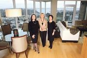 Seattle Realty Investment brokers, from left, Robin Wolcott, Barbara Brown and Carol Yuan-Hung Liu, gather in a $1.04 million, 25th-floor condo for sale in Bellevue Towers. The trio market local homes to Chinese buyers, for whom the Eastside is a choice destination.