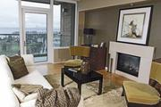 The living room of a 25th-floor condo listed by Seattle Realty Investment at $1.04 million in the Bellevue Towers building. The brokerage caters to a growing number of buyers from China looking for homes in the Seattle area.
