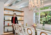 Broker Jessica Xu of Realogics Sotheby's International Realty in the banquet-sized dining room of a $4.3 million Kirkland home that she's marketing to buyers  in China.