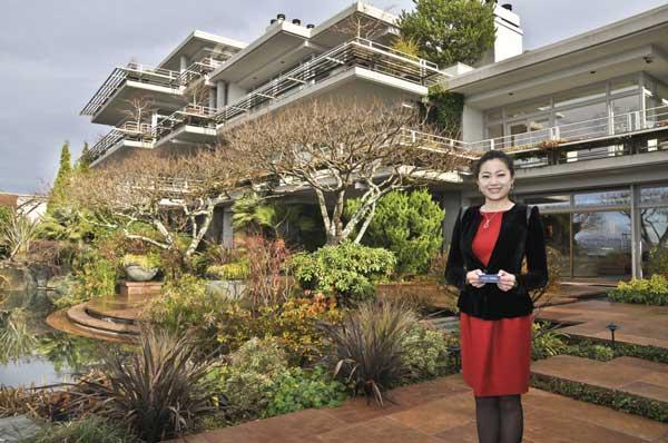 Broker Jessica Xu shows a Kirkland home that she's marketing to buyers in China. The 5,654-square-foot, three-bedroom home is listed for $4.3 million. Her company, Realogics Sotheby's International Realty, had the home's feng shui reviewed to make sure it would be attractive to Chinese buyers.