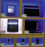 Coinstar's new Gizmo kiosks change lighting schemes to spotlight the item a customer chooses after searching using an interactive screen. Gizmo sells refurbished electronics including tablets, MP3 players, digital cameras, laptops and video game consoles.