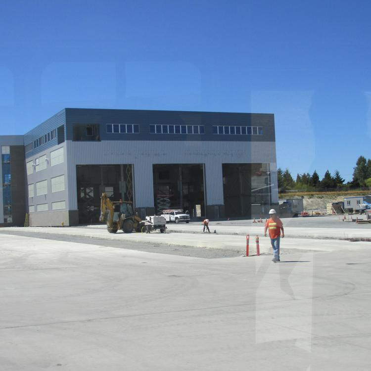 Workers are finishing the Dreamlifter Operations Center at Everett field, to speed assembly of 787 Dreamliners.