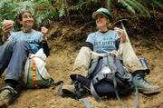 REI CEO Sally Jewell and an employee work on the Grand Ridge Trail near Issaquah.