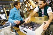 REI CEO Sally Jewell asks employee Paz Bensira about snowboard boots at REI's flagship store in Seattle. Jewell was so modest that Bensira did not initially realize he was talking to the CEO.