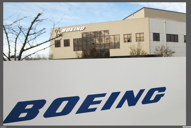 Boeing has purchased a 600,000-square-foot building housing its 787 Dreamliner modification center in Everett, suggesting it will bring more work to the area.