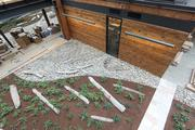 Seattle's new Federal Center South building features wood salvaged from a warehouse that previously stood on the site and an indoor garden and water features.