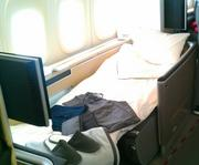The Lufthansa 747-8's eight first-class seats feature full beds, and walls that passengers can raise for privacy.
