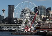 Construction on the Seattle Great Wheel on Pier 57, as seen from offshore aboard a ferry, continues on May 25.