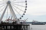 Work continues on the final details of construction of the Seattle Great Wheel on June 27.
