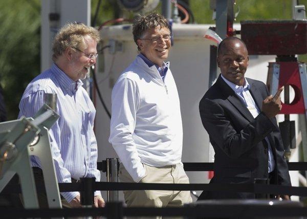 "Bill Gates, center, Nathan Myhrvold, left, and Doulaye Kone, senior program officer at the Bill & Melinda Gates Foundation, tour toilet displays during the foundation's ""Reinventing the Toilet"" fair in Seattle on Tuesday."