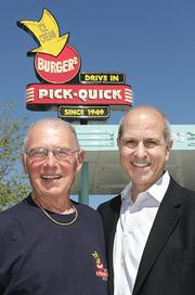 From left, Joe Burgi, whose family owns the original