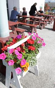 The new Auburn location of Pick-Quick Drive In features flower boxes and picnic tables just like the ones at the original Pick-Quick Drive In in Fife.