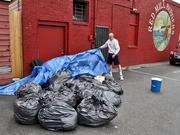 Shepherd uncovers three days of garbage so he can haul it himself to the garbage transfer station.