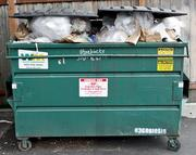 An overfull dumpster at a Starbucks on Phinney Ridge in Seattle.