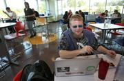 Joe Muharsky, a Google test engineer, enjoys lunch at the Sudo Cafe at Google's offices in Kirkland.