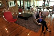 Google employee Katelin Todhunter-Gerber works on her mobile phone while sitting in an acrylic bubble chair at Google's offices in Kirkland.