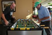 Google employees Derek Old, left, and Nash Foster take a break to play foosball in a lounge area at Google's offices in Kirkland.