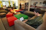 Jonathan Simon works in a lounge area at Google's offices in the Fremont area of Seattle.