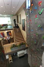 Google employees can use a rock-climbing wall during work breaks at their offices in Kirkland.