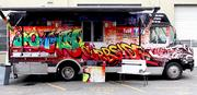 The brightly painted Nomad Curbside food truck offers gourmet burgers and sandwiches such as an apple and sage croque monsieur at locations around Seattle.