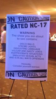 "The warning sign greeting the audience as they stream in to see ""Miracle!"" a play by sex columnist Dan Savage, which is loosely based on the life of Helen Keller - had she been a part of Seattle's 1990s drag scene."