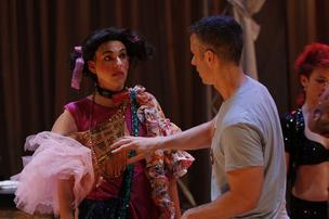 "Dan Savage coaches actor Jonathon Pyburn in his role as Helen Stellar in ""Miracle!"""