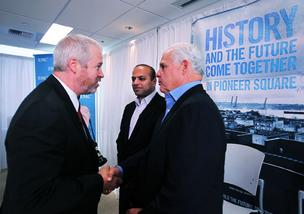 Seattle Mayor Mike McGinn (left) shakes hands with EMC CEO Joe Tucci (right) while EMC Isilon storage division President Sujal Patel of Seattle looks on, following a press conference at Isilon's Pioneer Square headquarters Wednesday.