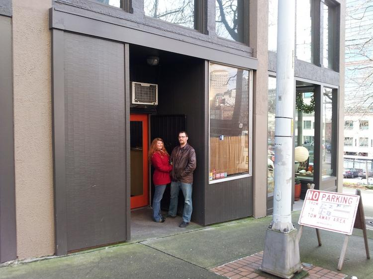 Rhi Brunett and Ray Bailey of Tacoma wait to get into Tsukushinbo, on Main Street in Seattle between Fifth and Sixth avenues.