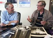 In an interview with Puget Sound Business Journal Editor George Erb, at left, retired Seattle photojournalist Bruce McKim relates some of the details of a few of the thousands of photos McKim shot and processed while working on the photo staff of the 1962 Seattle World's Fair.