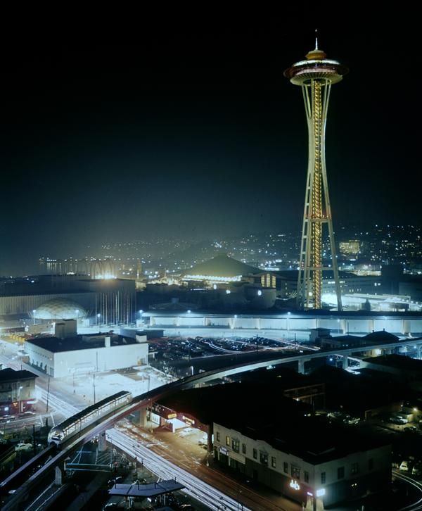 "The Space Needle and Monorail are pictured in this nighttime, long-exposure photograph taken as part of Sylvania's annual ""Big Shot"" photograph project during the 1962 Seattle World's Fair.  This archive photo was shot from the then-Grosvenor House building in the Belltown neighborhood by longtime Seattle photojournalist Bruce McKim."
