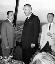 Vice President Lyndon Johnson (center), Sen. Warren Magnuson, D-Wash. (left), and Seattle Space Needle manager Hoge Sullivan take in the views from the Space Needle observation deck in the summer of 1962. The archive photo was taken by Seattle photojournalist Bruce McKim.
