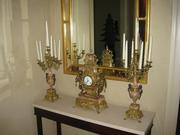 Imperial clock, candelabras and mirror.