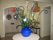 Glass floral sculpture with 10 leaves, 17 flowers and glass vase.