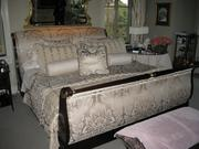 Queen-size sleigh bed with floral headboard.