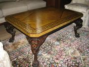 Claw-foot coffee table with burl top and inlay and 18-foot-by-15-foot Persian carpet.