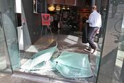 The front doors of Niketown on Sixth Avenue in Seattle were smashed during a midday May Day march Tuesday. The store was also hit with smoke bombs and paint.
