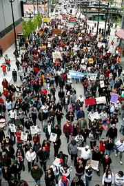 A May Day immigration rally drew a large crowd of protesters to downtown Seattle on Tuesday evening.