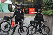 Seattle police officers stand guard in downtown Seattle on Tuesday evening.