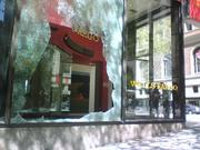 Anarchists smashed windows at the Wells Fargo branch at Fourth Avenue and Seneca Street in downtown Seattle in midday May Day protests on Tuesday.