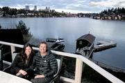 8.           At home with Crystal Mountain's John and Kim KircherKim and John Kircher relax on the deck of their Medina home overlooking their  boathouse on Meydenbauer Bay, with the downtown Bellevue skyline in the  background. John Kircher is the president and general manager of  Crystal Mountain and president of Boyne Resorts' western operations in Utah, Washington and Vancouver, B.C. The Kirchers were featured in a PSBJ Northwest Homes special section.More images here.