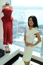 """6.           Couture designer Luly Yang dresses downtown Seattle condo in styleSeattle fashion designer Luly Yang in the living room of her Seattle condo overlooking the Elliott Bay waterfront. The red dress, """"Fire Coral,"""" is from Yang's """"Ocean"""" collection.       Photographer Anthony Bolante got up close and personal with a woman of style who has Seattle at her feet.More images here."""