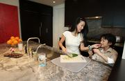Designer Luly Yang and her son, Lukas, in the kitchen of Yang's downtown Seattle condo.