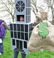 Rhiannon Hemsted came as Wall Street to a a Tax Day protest calling for Amazon.com to pay more in federal taxes.