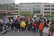 Deomonstrators gathers outside Amazon headquarters protesting what they say is Amazon's low tax rate.