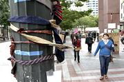 Men's ties adorn a lamppost in Westlake Park as part of Occupy Seattle.